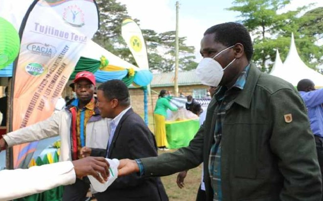 Agriculture Cabinet Secretary Peter Munya (right) and Pan Africa Climate Justice Alliance Executive Director during the launch of a sunflower farming project at Kanuni in Igembe South on September 11, 2020. [Phares Mutembei, Standard]
