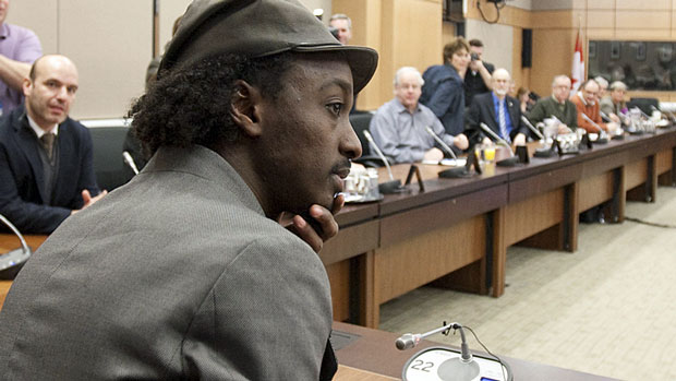 Canadian musician K'naan attends an NDP caucus meeting in Ottawa on Wednesday. He was on Parliament Hill to support an NDP bill on generic drugs for the developing world.
