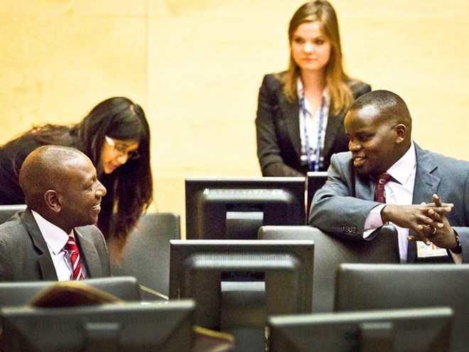 Deputy President William Ruto and journalist Joshua Sang chat at the ICC. Photo/FILE