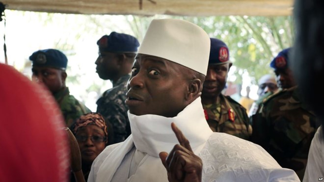 Gambia's president Yahya Jammeh shows his inked finger before voting in Banjul, Gambia, Dec. 1, 2016.