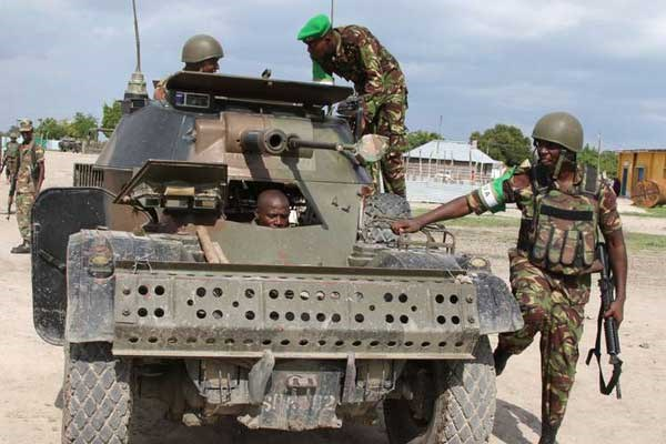 KDF soldiers on patrol in Afmadow, Somalia. On Saturday, March 19, 2016, KDF soldiers killed 21 Al-Shabaab militants in a shootout in Lower Juba Region in Somalia and recovered weapons. Two Kenyan soldiers also died in the shootout. PHOTO   JEFF ANGOTE   NATION MEDIA GROUP