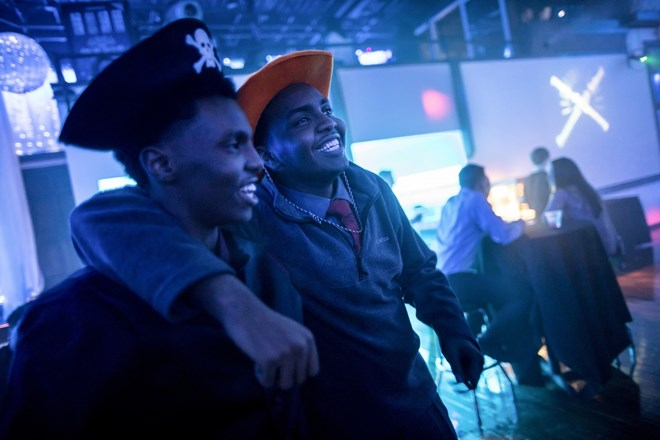 Mohamed Hassan wrapped his arm around he younger brother Ali Hassan as they hung out at a Roosevelt High School school dance at the Profile Event Center in Minneapolis, Minn. on February 16, 2017. They had on props from a photo booth.Renee Jones Schneider