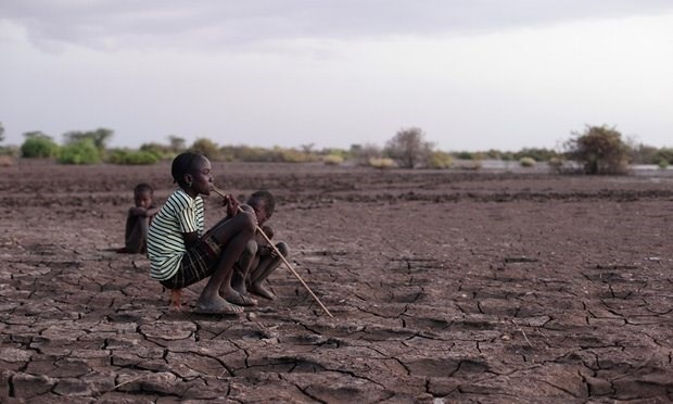 Children sitting on the Omo river bank, which is cracked due to falling water levels. Photograph: Alamy