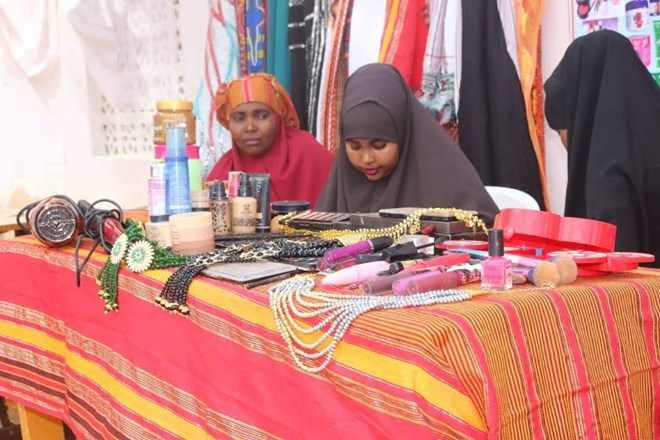 Young women show their products to participants at a job fair, in Dhusamareeb, Galmadug, August 2018. The fair is one of many being run around the country by Federal Member State Ministries in collaboration with the Federal Government and the United Nations (UN) support, as part of a week of International Youth Day events.