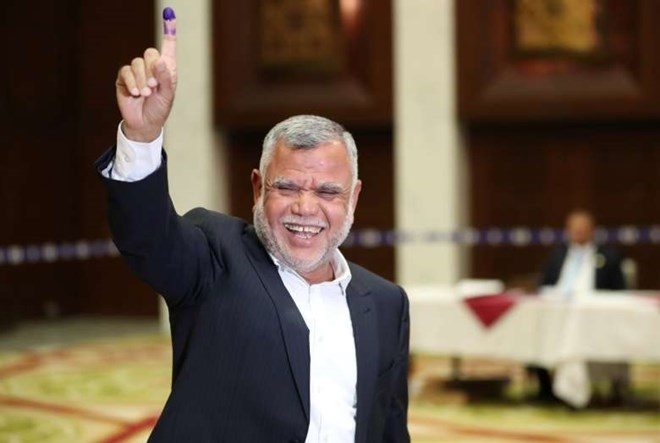 Leader of the Al-Fatih bloc Hadi al-Amiri shows his ink-stained finger after casting his vote in Baghdad last Saturday. (Ahmed Jadallah/Reuters)