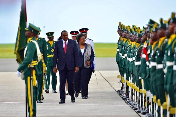President Uhuru Kenyatta and Barbados Prime Minister Mia Mottley inspect a guard of honour after the Kenyan leader arrived in the capital Bridgetown. PHOTO | COURTESY