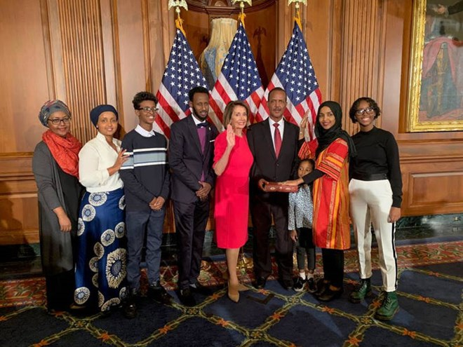 House Speaker Nancy Pelosi of Calif., second from left, poses during a ceremonial swearing-in with Rep. Ilhan Omar, D-Minn., second from right, on Capitol Hill in Washington, Jan. 3, 2019.
