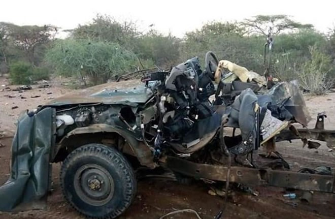 Photo taken on Oct. 12, 2019 shows a destroyed vehicle at the site of a blast in Garissa county, Kenya. A roadside blast killed at least 10 Kenyan paramilitary police officers in Garissa county along Kenya-Somalia border on Saturday, a security official said. (Photo by Chris Mgidu/Xinhua)